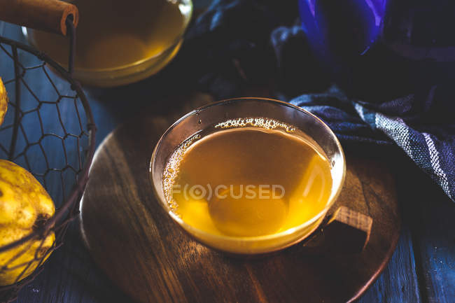 Tea cup of homemade hot quince infusion — Foto stock