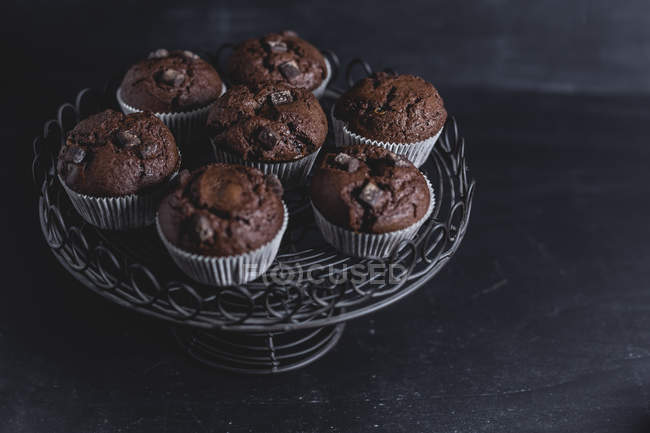 Chocolate muffins on cake stand — Stock Photo
