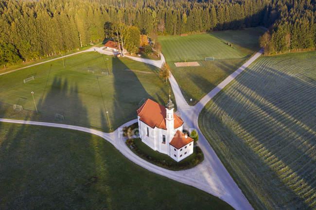 Germany, Bavaria, St. Leonhard church near Dietramszell, drone view — Stock Photo