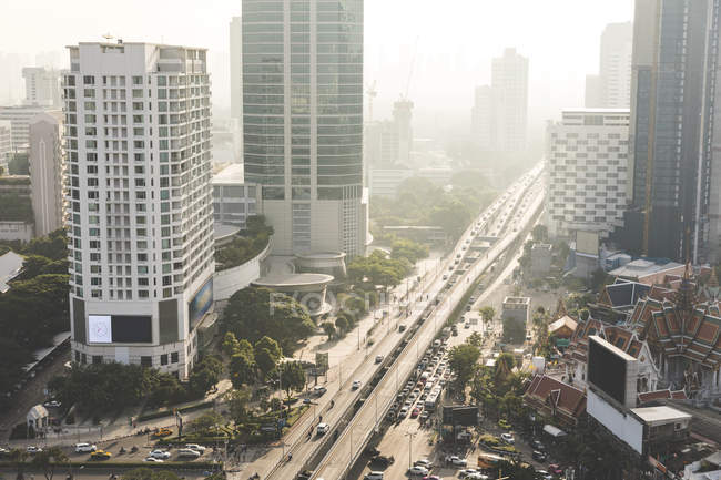 Thailand, Bangkok, aerial view of highway and skyscrapers in the city — Stock Photo