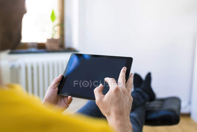 Close-up of man using tablet at home — Stock Photo