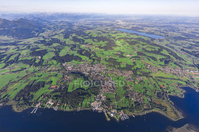 Germany, Bavaria, Aerial view of Lake Chiemsee, Prien, Rimsting and Schafwaschener Winkel in the foreground. Rosenheim and Simsee in the background — Stock Photo