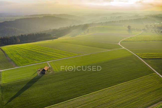 Germania, Baden-Wuerttemberg, Foresta sveva, Valle di Fils, Vista aerea al tramonto — Foto stock