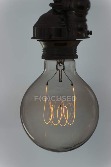 Light bulb with glowing filament — Stock Photo