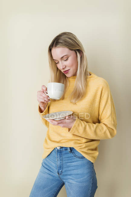 Portrait of a young woman, drinking coffee — Stock Photo