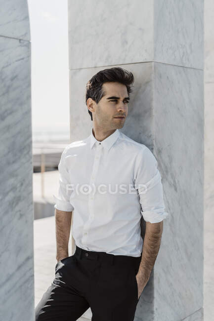 Portrait of fashionable man weraing white shirt and black trousers — Stock Photo