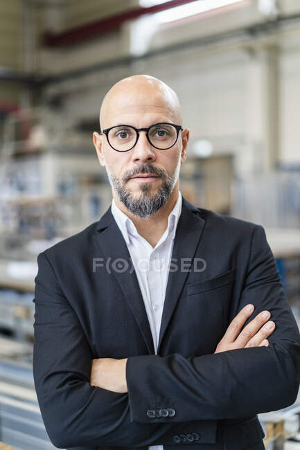 Portrait of confident businessman in factory — Stock Photo