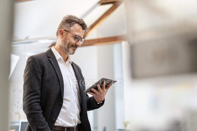 Businessman using tablet in office — Stock Photo