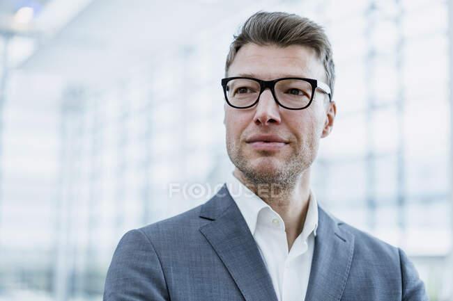 Portrait of confident businessman with glasses — Stock Photo