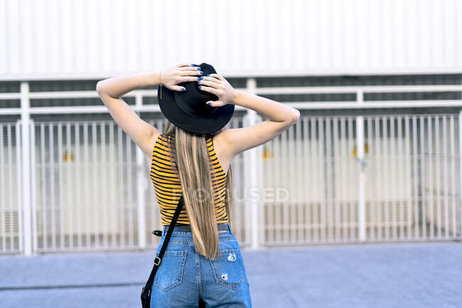 Rear view of teenage girl wearing hat — Stock Photo