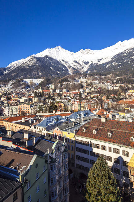 Austria, Tyrol, Innsbruck, Panoramic views of the city with snow-capped Alps in background — Stock Photo