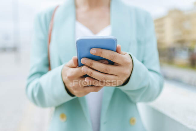 Close-up of woman's hands with smartphone — Stock Photo