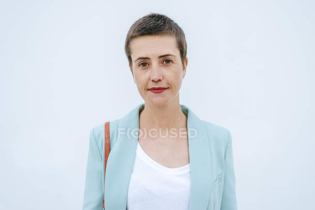 Portrait of woman with jacket, white background — Stock Photo