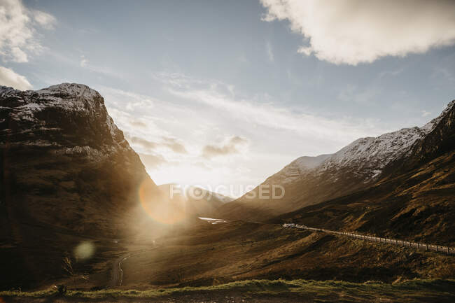 UK, Scotland, Glencoe, road through the mountains in backlight — Stock Photo