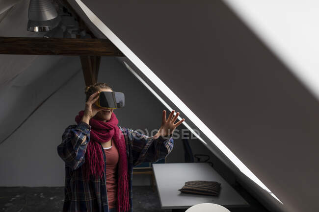 Happy young woman wearing VR glasses — Stock Photo