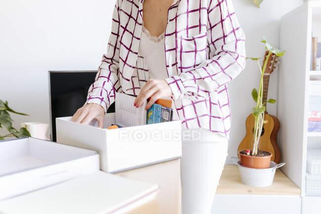 Woman sorting belongings at home, partial view — Stock Photo