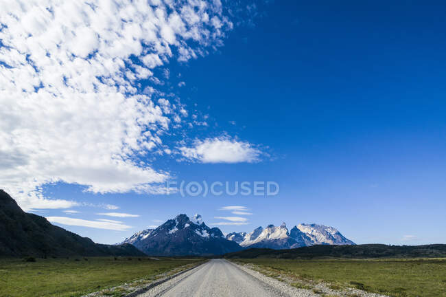 Chile, Patagonia, Straight road leading through the Torres del Paine National Park — Stock Photo