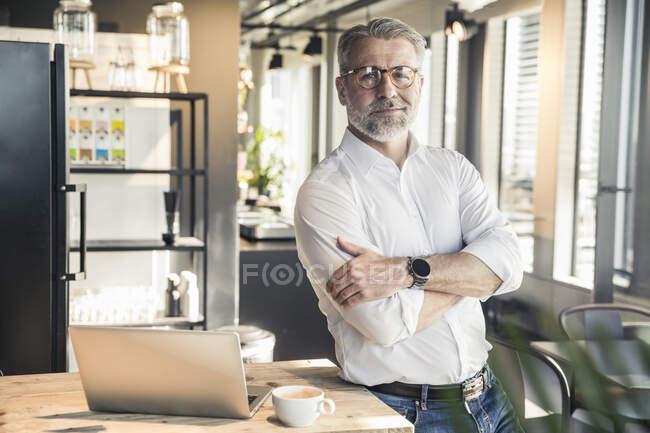 Portrait of confident mature businessman in office — Stock Photo