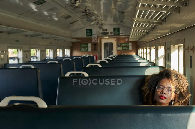Portrait of young woman in a train — Stock Photo