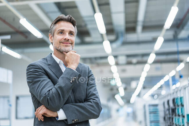 Portrait of a confident businessman in a modern factory — Stock Photo