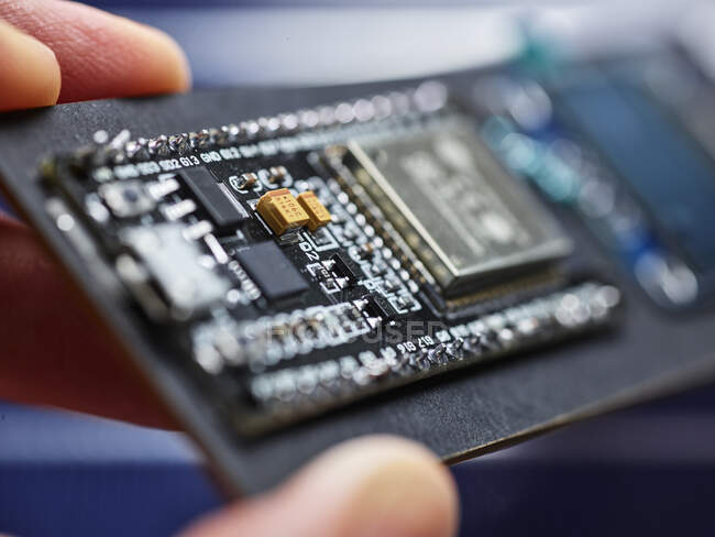 Detail of hand holding circuit board — Stock Photo