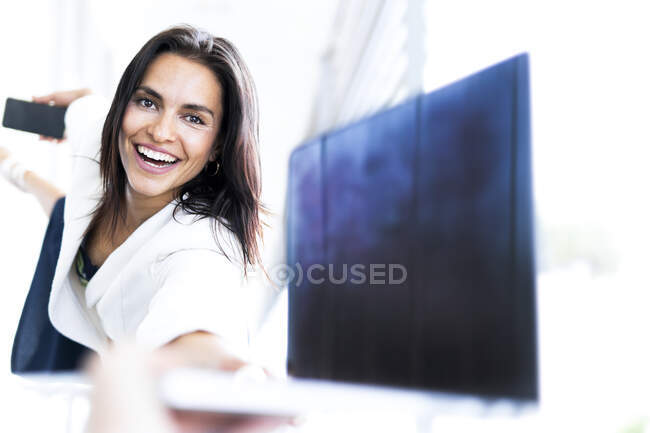 Female ballet dancer with tablet and smartphone — Stock Photo