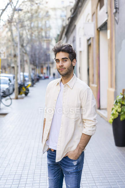 Portrait of a man standing on pavement — Stock Photo