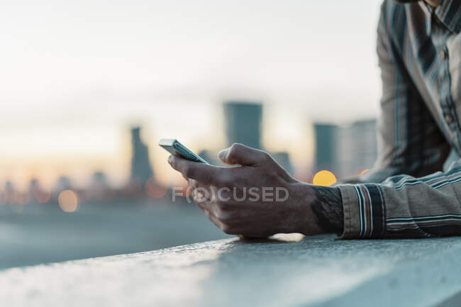 Man's hand holding mobile phone, Barcelona, Spain — Stock Photo