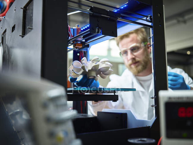 Technician with turbine wheel being printed in 3d printer — Stock Photo
