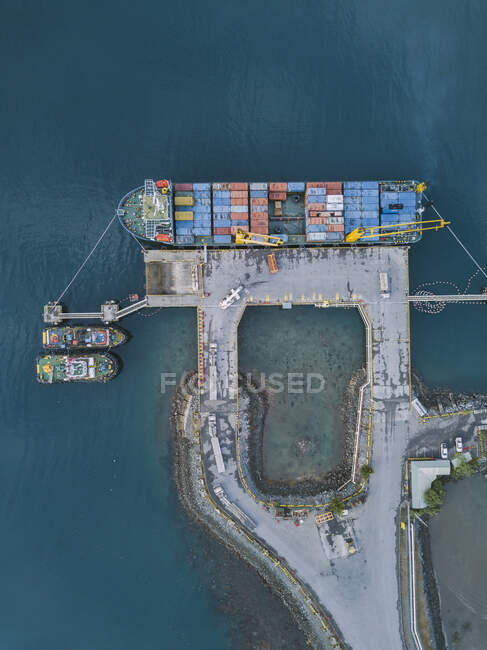 Indonesia, Sumbawa, Maluk, Aerial view of harbor, container ship from above — Stock Photo