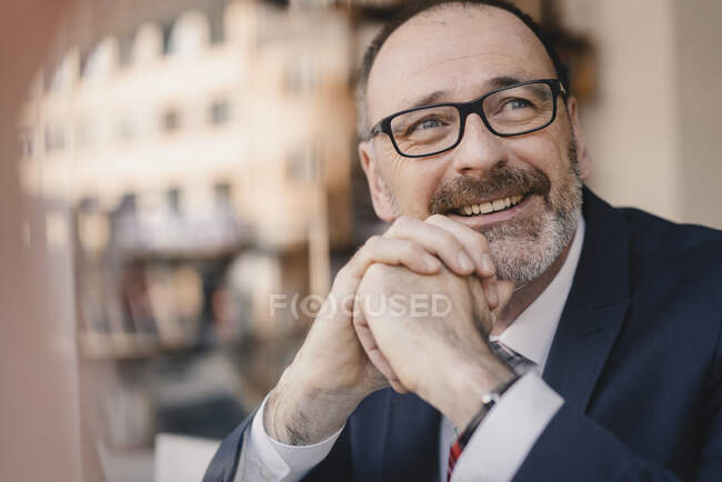 Portrait of smiling mature businessman in a cafe — Stock Photo