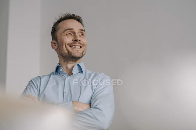 Portrait of a successful businessman, smiling with arms crossed — Stock Photo