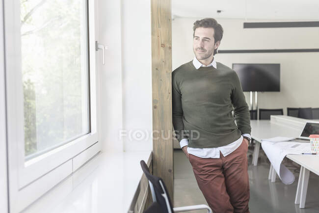 Successful, young businessman in boardroom — Stock Photo