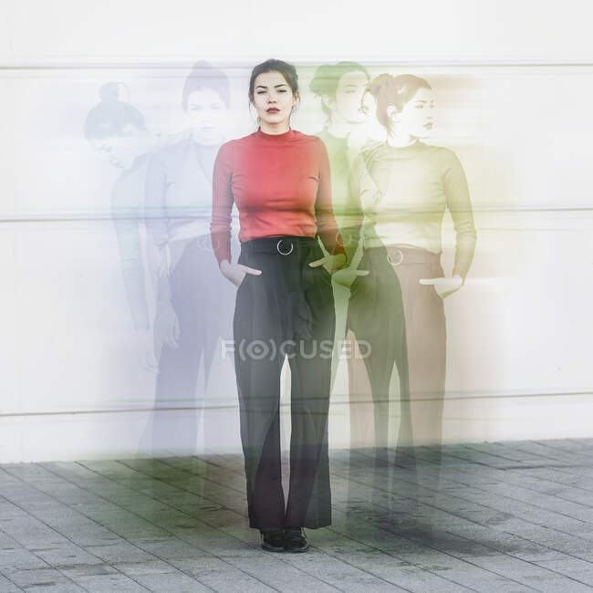 Digital composite of young woman in front of a wall — Stock Photo