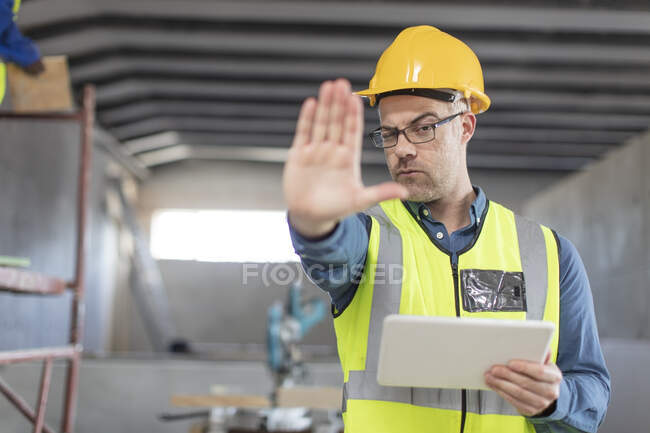 Architect using laptop at construction site — Stock Photo