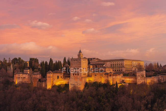 View of Alhambra with mountain Sierra Nevada in the background at sunset, Granada, Spain — Stock Photo