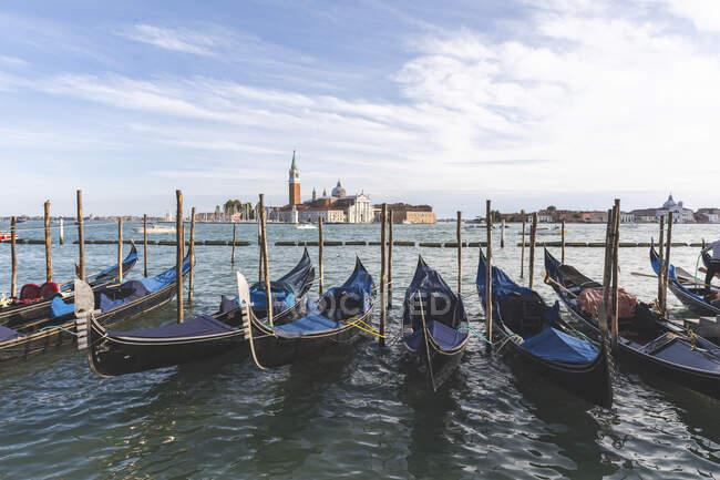 View to San Giorgio Maggiore with row of gondolas in the foreground, Venice, Italy — Stock Photo