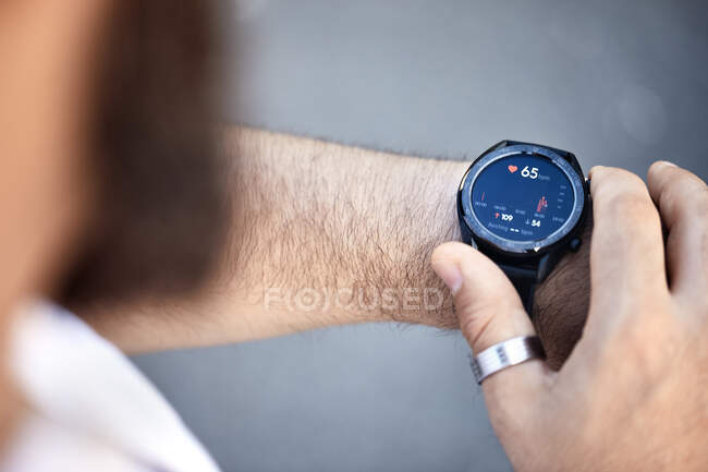 Close-up of man checking medical data on smartwatch — Stock Photo