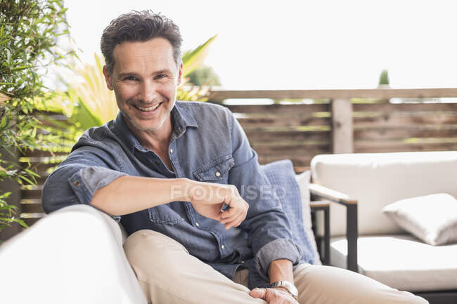 Confident man relaxing on the terrace — Stock Photo