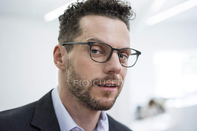 Portrait of confident businessman in office — Stock Photo