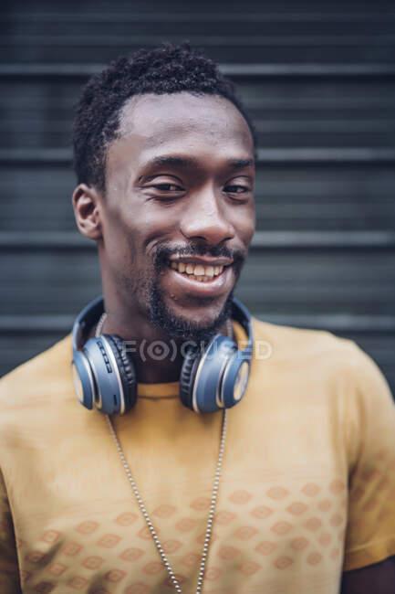 Portrait of smiling man with headphones — Stock Photo