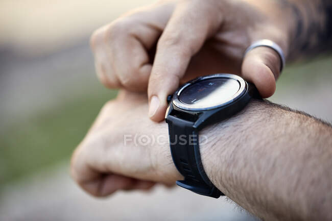 Close-up of man checking smartwatch — Stock Photo