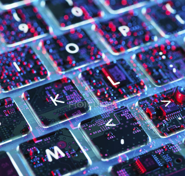 Double exposure of a laptop computer showing electronic components under the keyboard — Stock Photo