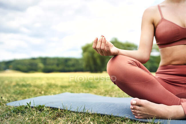 Close-up of woman practicing yoga in park — Stock Photo
