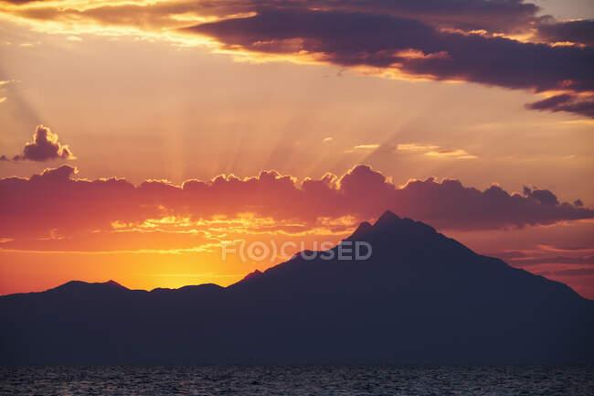 Greece, Halkidiki, Sea and Athos Mountain at sunrise — Stock Photo