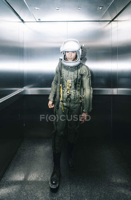 Man posing dressed as an astronaut in an elevator — Stock Photo