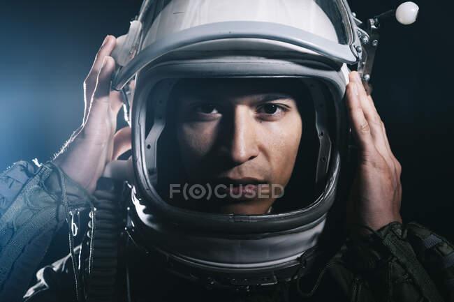 Man posing dressed as an astronaut in skyrocket elevator — Stock Photo