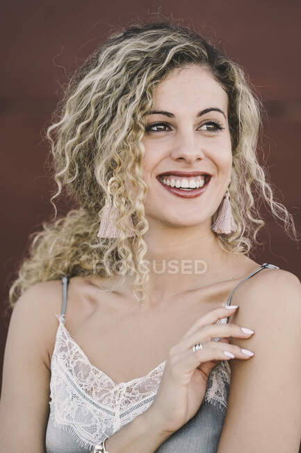Portrait of fashionable young woman with dyed blond ringlets — Stock Photo