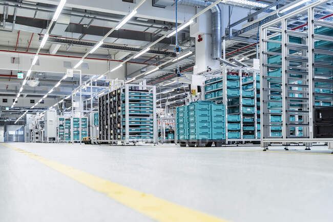 Stacked containers inside modern factory warehouse, Stuttgart, Germany — Stock Photo