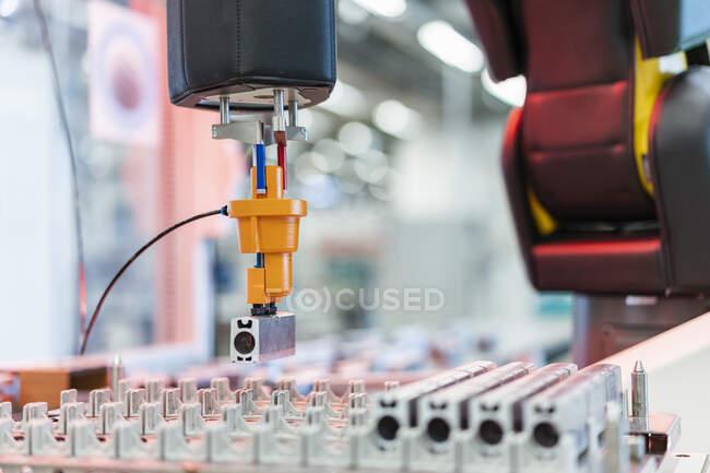 Arm of assembly robotpicking up machine part, Stuttgart, Germany — Stock Photo